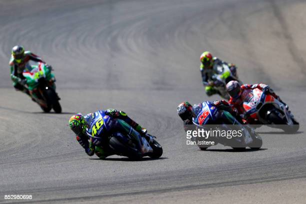 Valentino Rossi of Italy and Movistar Yamaha MotoGP rides ahead of Maverick Vinales of Spain and Movistar Yamaha MotoGP and Andrea Dovizioso of Italy...
