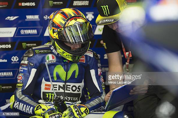 Valentino Rossi of Italy and Movistar Yamaha MotoGP speaks in box with mechanics during the MotoGP Netherlands Qualifying at TT Assen Circuit on June...