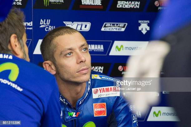 Valentino Rossi of Italy and Movistar Yamaha MotoGP speaks with mechanics in box during the MotoGP of Aragon Free Practice at Motorland Aragon...