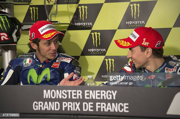 Valentino Rossi of Italy and Movistar Yamaha MotoGP speaks with Jorge Lorenzo of Spain and Movistar Yamaha MotoGP during the press conference at the...