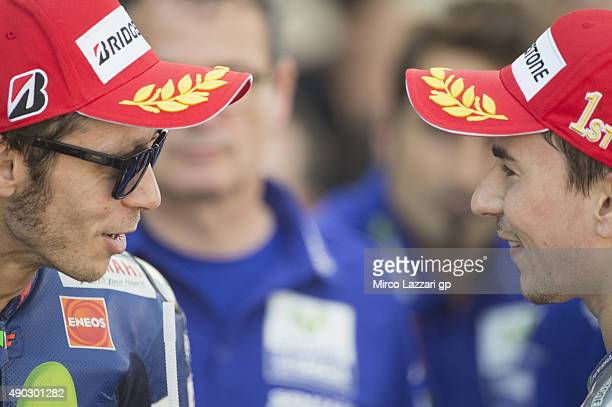 Valentino Rossi of Italy and Movistar Yamaha MotoGP speaks with Jorge Lorenzo of Spain and Movistar Yamaha MotoGP at the end of the MotoGP race...