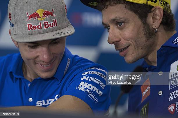 Valentino Rossi of Italy and Movistar Yamaha MotoGP speaks with Maverick Vinales of Spain and Team Suzuki ECSTAR during the press conference at the...