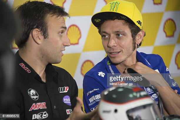 Valentino Rossi of Italy and Movistar Yamaha MotoGP speaks with Johann Zarco of France and Ajo Motorsport during the press conference at the end of...
