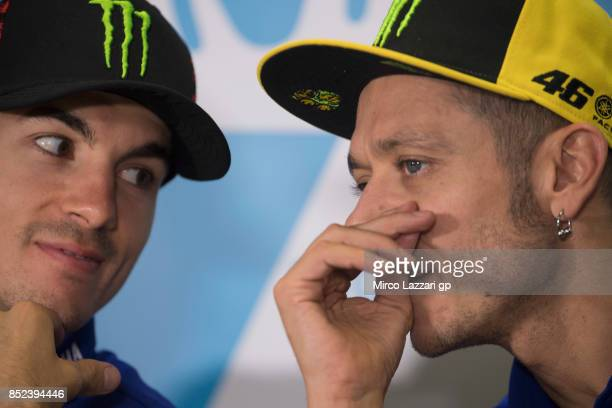 Valentino Rossi of Italy and Movistar Yamaha MotoGP speaks with Maverick Vinales of Spain and Movistar Yamaha MotoGP during the press conference at...