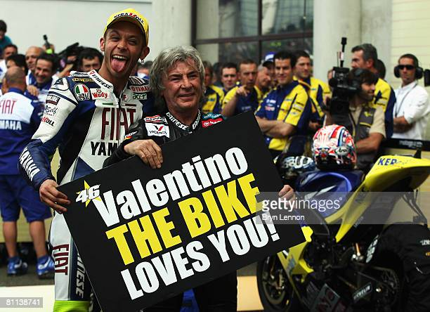 Valentino Rossi of Italy and the Fiat Yamaha Team celebrates equalling the race win record of Angel Nieto at the MotoGP of France at the Le Mans...