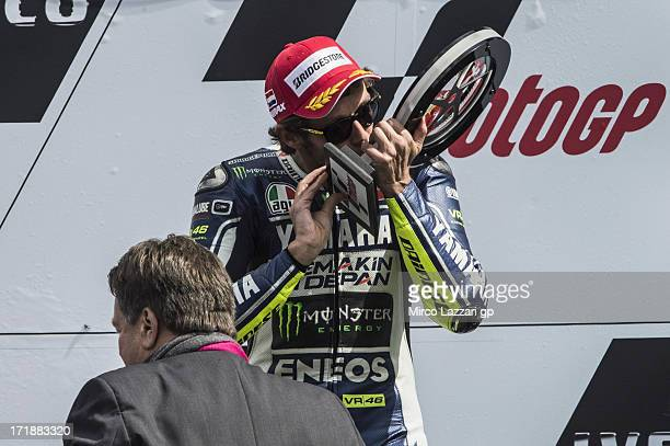 Valentino Rossi of Italy and Yamaha Factory Racing celebrates victory on the podium at the end of the MotoGP race during the MotoGp Of Holland Race...
