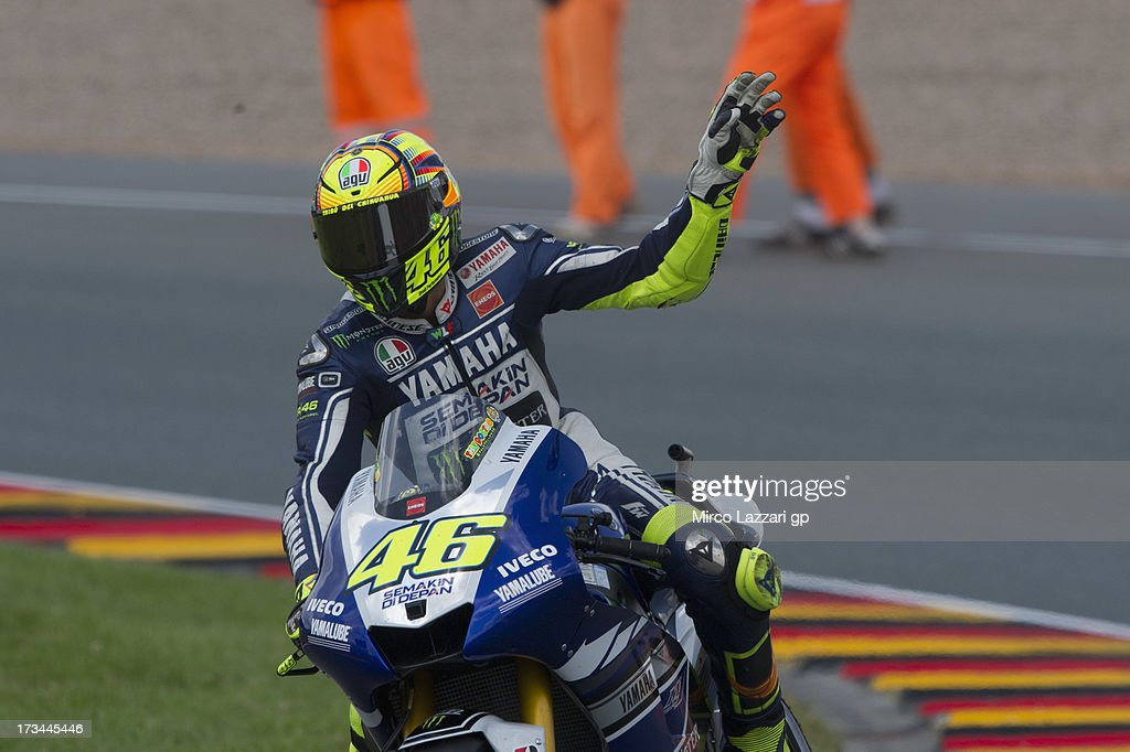 <a gi-track='captionPersonalityLinkClicked' href=/galleries/search?phrase=Valentino+Rossi&family=editorial&specificpeople=157603 ng-click='$event.stopPropagation()'>Valentino Rossi</a> of Italy and Yamaha Factory Racing greets the fans and celebrates the third place at the end of the MotoGP race during the MotoGp of Germany - Race at Sachsenring Circuit on July 14, 2013 in Hohenstein-Ernstthal, Germany.