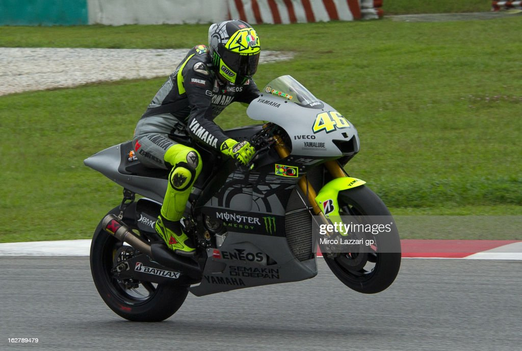 Valentino Rossi of Italy and Yamaha Factory Racing lifts the front wheel during the MotoGP Tests in Sepang - Day Two at Sepang Circuit on February 27, 2013 in Kuala Lumpur, Malaysia.