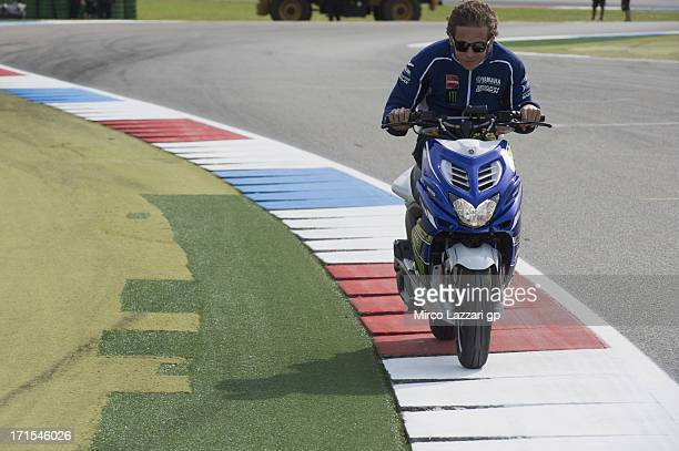 Valentino Rossi of Italy and Yamaha Factory Racing rides a scooter on track during the MotoGp Of Holland Previews at TT Circuit Assen on June 26 2013...