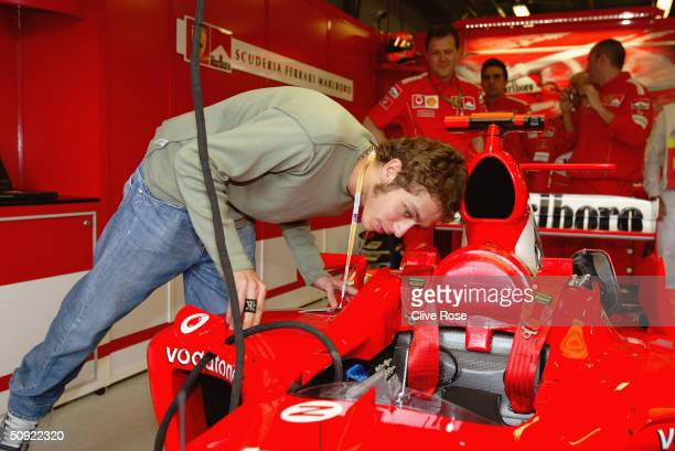 Valentino Rossi of Italy and Yamaha inspects the 2004 Ferrari at the 2004 Australian Grand Prix on March 7th 2004 at the Albert Park Circuit in...