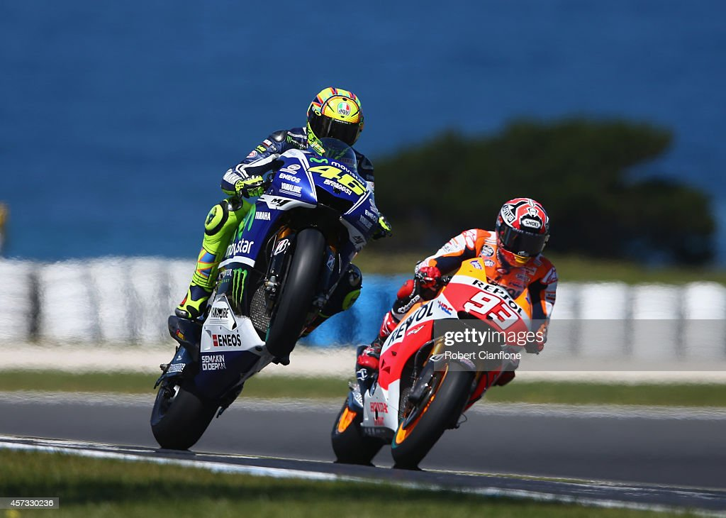 Valentino Rossi of Italy rides the #46 Movistar Yamaha MotoGp Yamaha past Marc Marquez of Spain rides the #93 Repsol Honda Team Honda during free practice for the 2014 MotoGP of Australia at Phillip Island Grand Prix Circuit on October 17, 2014 in Phillip Island, Australia.