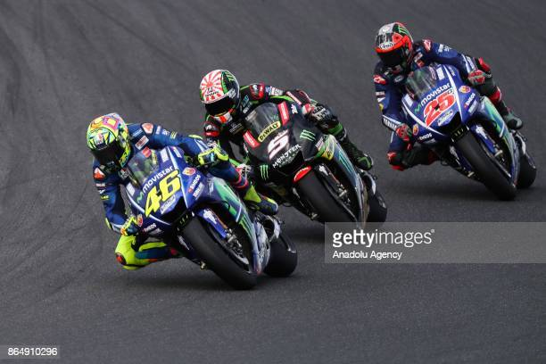 Valentino Rossi of Italy riding for Movistar Yamaha MotoGP ahead of Johann Zarco of France riding for Monster Yamaha Tech 3 and Maverick Vinales of...