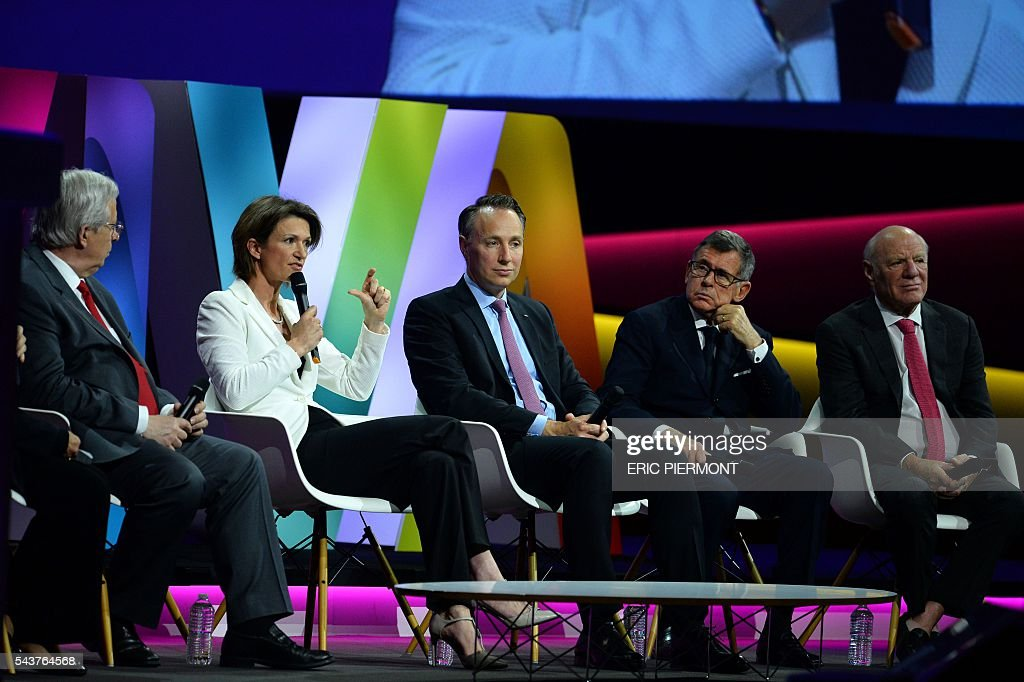 Valeo Chairman and CEO Jacques Aschenbroich, Engie CEO Isabelle Kocher, AXA Deputy CEO and incoming CEO Thomas Buberl, Carrefour Chairman and CEO Georges Plassat and IAC and Expedia Chairman and Senior Executive Barry Diller attend a session at the Viva Technology event in Paris on June 30, 2016. / AFP / ERIC