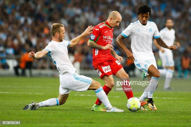 Valere Germain and Luiz Gustavo of Marseille and Franck Berrier of Ostende during the UEFA Europa League qualifying match between Marseille and...