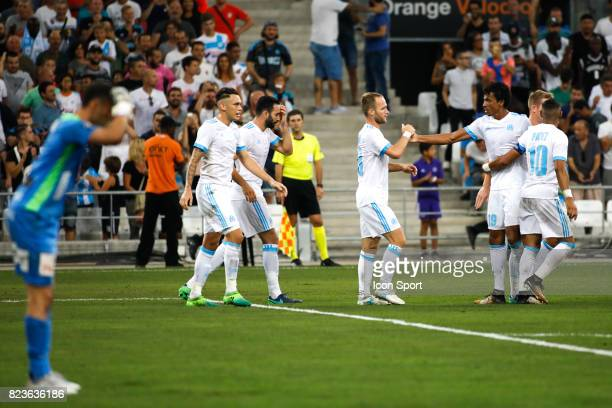 Valere Germain and Luiz Gustavo of Marseille celebrate his goal during the UEFA Europa League qualifying match between Marseille and Ostende at Stade...