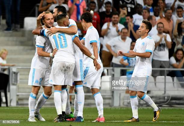 Valere Germain forward of OM celebrates with teammates after scoring pictured during Europa league third qualifying round 1st leg match between...