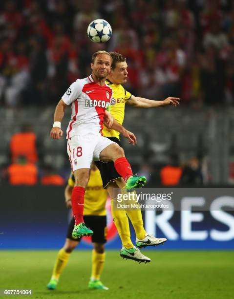 Valere Germain of AS Monaco and Matthias Ginter of Borussia Dortmund battle for an aerial ball during the UEFA Champions League Quarter Final first...