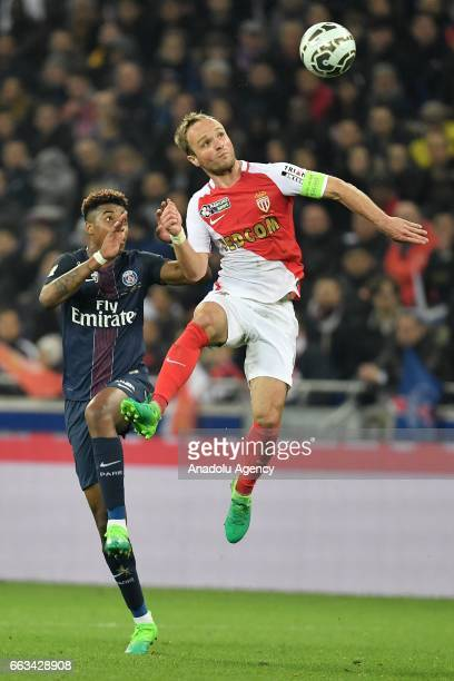 Valere Germain of AS Monaco in action against Presnel Kimpembe of Paris SaintGermain during the French League Cup final football match between AS...