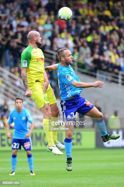 Valere Germain of Marseille and Nicolas Pallois of Nantes during the Ligue 1 match between FC Nantes and Olympique Marseille at Stade de la Beaujoire...