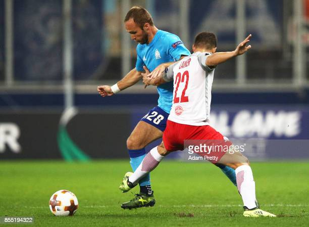 Valere Germain of Marseille is challenged by Stefan Lainer of Red Bull Salzburg during the UEFA Europa League group I match between RB Salzburg and...