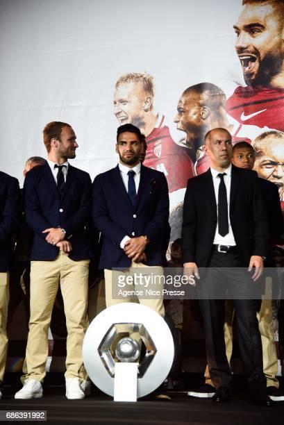 Valere Germain Radamel Falcao and Leonardo Jardim head coach of Monaco with the trophy during AS Monaco French Ligue 1 Winners Parade on May 21 2017...