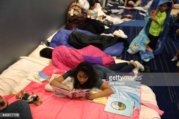 Valeri Delgado and her family take shelter at the George R Brown Convention Center after flood waters from Hurricane Harvey inundated the city on...