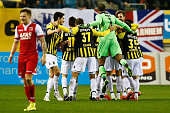 Valeri Kazaishvili of Vitesse is jumped on by team mates after scoring the third goal of the game during the Dutch Eredivisie match between Vitesse...