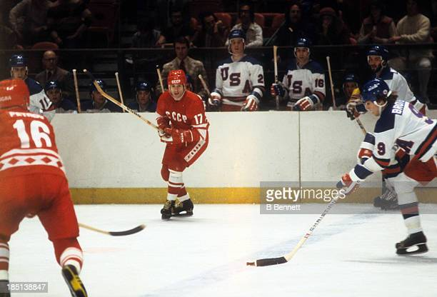 Valeri Kharlamov of the USSR looks to defend against Neal Broten of Team USA during an 1980 exhibition game on February 9 1980 at the Madison Square...