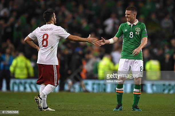Valeri Qazaishvili of Georgia and James McCarthy of Republic of Ireland shake hands after the full time whistle in the FIFA 2018 World Cup Group D...
