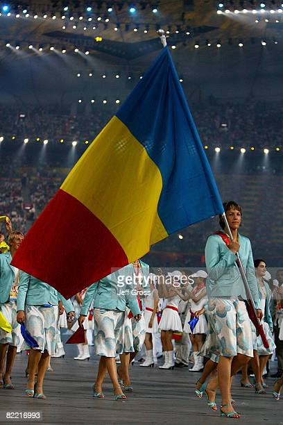 Valeria Bese of Romania carries her country's flag during the Opening Ceremony for the 2008 Beijing Summer Olympics at the National Stadium on August...