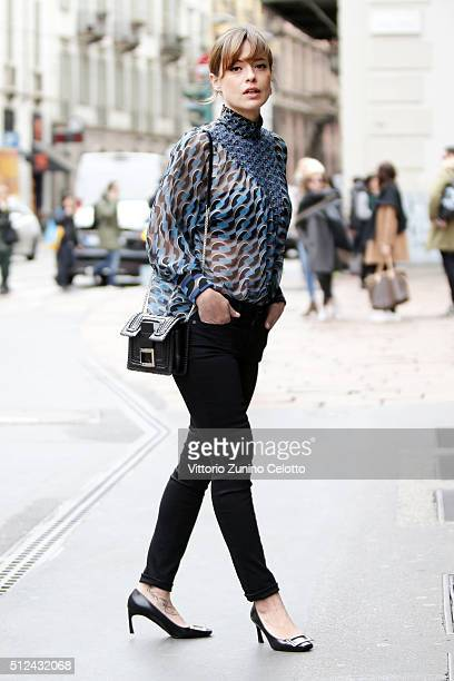Valeria Bilello wearing shoes and bag by Roger Vivier Fendi shirt and Denham jeans Seen during the Milan Fashion Week Fall/Winter 2016/17 on February...