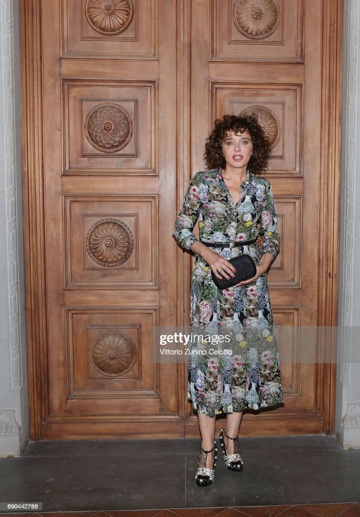 Valeria Golino arrives at the Gucci Cruise 2018 fashion show at Palazzo Pitti on May 29, 2017 in Florence, Italy.