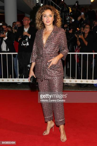 Valeria Golino walks the red carpet ahead of the 'Emma ' screening during the 74th Venice Film Festival at Sala Grande on September 7 2017 in Venice...