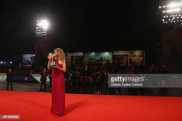 Valeria Golino with her Coppa Volpi award for Best Actress for 'Per Amore Vostro' attends the award winners photocall during the 72nd Venice Film...