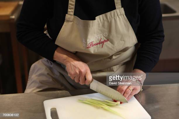 Valeria Hensemberger cuts celery to make soffritto a mix of onion carrot and celery fried in olive oil and the base of many Italian sauces including...
