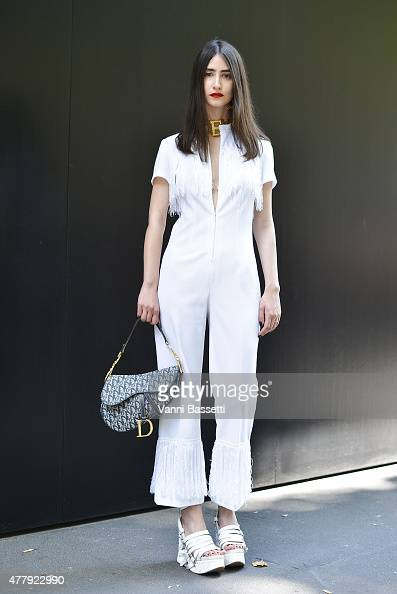 Valeria Lazzarini poses wearing a vintage dress KTZ shoes and Dior bag on June 20 2015 in Milan Italy