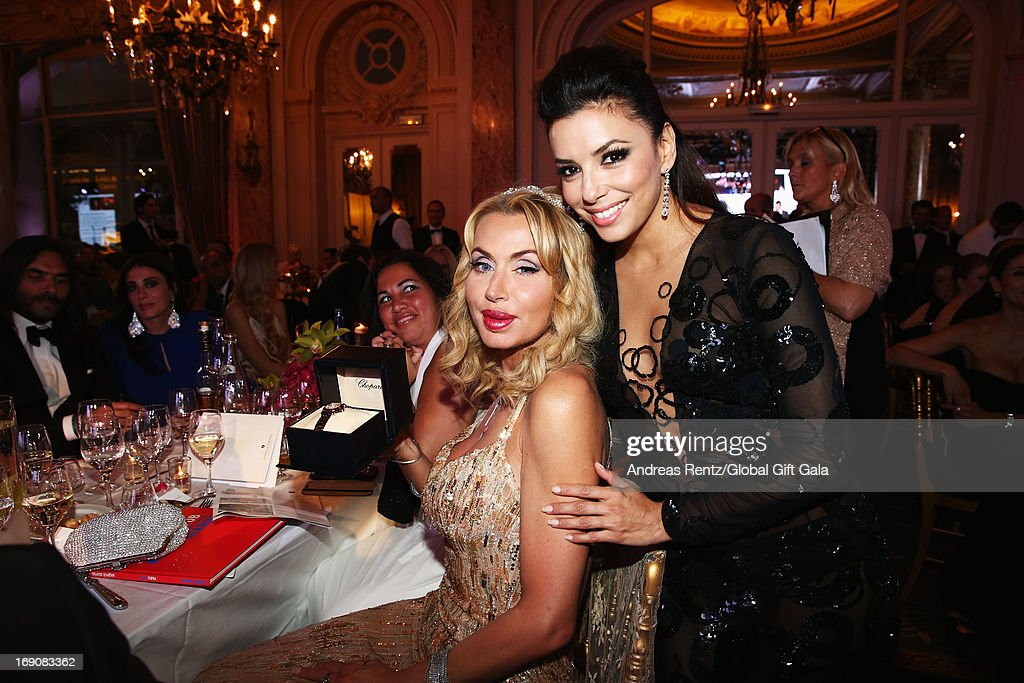 Valeria Marini and <a gi-track='captionPersonalityLinkClicked' href=/galleries/search?phrase=Eva+Longoria&family=editorial&specificpeople=202082 ng-click='$event.stopPropagation()'>Eva Longoria</a> attend the 'Global Gift Gala' 2013 dinner and auction presented by <a gi-track='captionPersonalityLinkClicked' href=/galleries/search?phrase=Eva+Longoria&family=editorial&specificpeople=202082 ng-click='$event.stopPropagation()'>Eva Longoria</a> at Carlton Hotel on May 19, 2013 in Cannes, France.