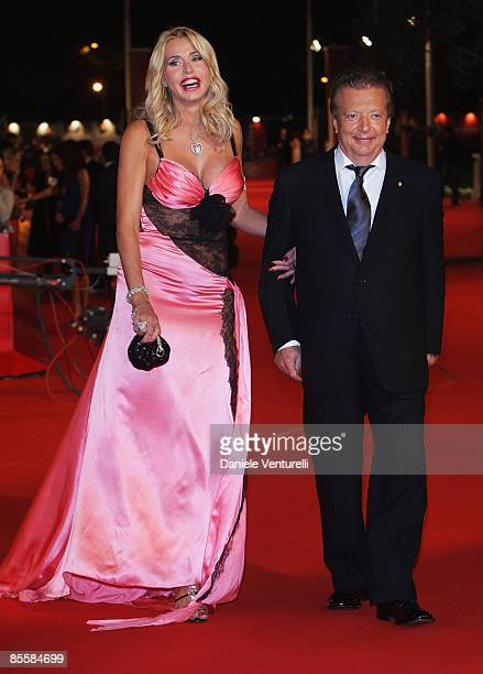 Valeria Marini and producer Vittorio Cecchi Gori arrive at the Marc'Aurelio Acting Award during the 3rd Rome International Film Festival held at the...