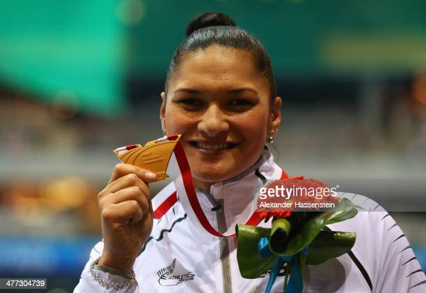 Valerie Adams of New Zealand celebrates winning the gold medal in the Women's Shot Put final during the medal ceremony on day two of the IAAF World...