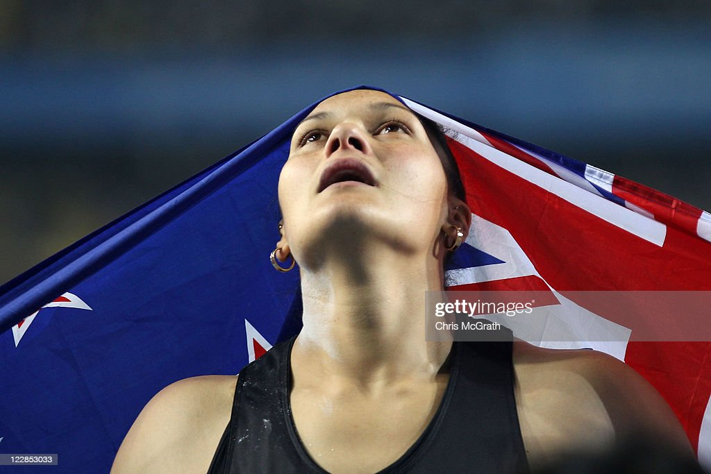 <a gi-track='captionPersonalityLinkClicked' href=/galleries/search?phrase=Valerie+Adams&family=editorial&specificpeople=2174723 ng-click='$event.stopPropagation()'>Valerie Adams</a> of New Zealand celebrates with her country's flag after winning the women's shot put final during day three of the 13th IAAF World Athletics Championships at the Daegu Stadium on August 29, 2011 in Daegu, South Korea.