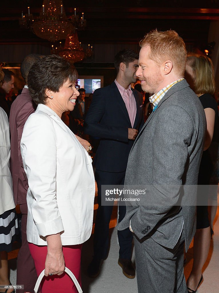 Valerie Bowman Jarrett and <a gi-track='captionPersonalityLinkClicked' href=/galleries/search?phrase=Jesse+Tyler+Ferguson&family=editorial&specificpeople=633114 ng-click='$event.stopPropagation()'>Jesse Tyler Ferguson</a> (R) attend the PEOPLE/TIME WHCD cocktail party at St Regis Hotel - Astor Terrace on May 2, 2014 in Washington, DC.