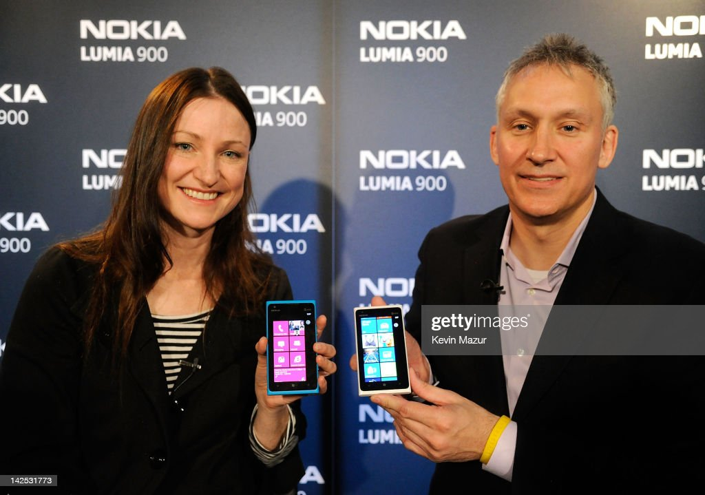 Valerie Buckingham, Marketing director, Nokia North America, and Chris Weber President of Nokia arrives at Times Square to watch Nicki Minaj team up with Nokia to perform live for the launch of the Nokia Lumia 900 with Windows Phone in North America at R Lounge at the Renaissance New York Times Square Hotel on April 6, 2012 in New York City. Tens of thousands of people watched as a building appeared to 'come alive' in the heart of New York City. Nine of Times Square's famous electronic screens captured the reaction of the crowds. The entire show was filmed as a backdrop for the music video for the exclusive Nokia Lumia 900 remix of Minaj's hit 'Starships'. The Windows Phone-based Nokia Lumia 900 will be available in unique and eye-catching cyan blue and a matte black with a new high-gloss white version on sale later this month. To watch more of the amazing event go to www.facebook.com/nokiaus