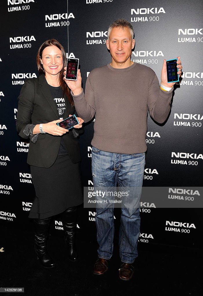 Valerie Buckingham, Marketing director of Nokia North America and Chris Weber, President of Nokia North America, arrive at Times Square for the launch of the Nokia Lumia 900 at R Lounge at the Renaissance New York Times Square Hotel on April 6, 2012 in New York City. The Windows phone will be available exclusively in America on AT&T from April 8. The outstanding new design allows customers to access their contacts, email, music and social media in one place. It is available in unique and eye-catching cyan blue and a matte black with a new high-gloss white version on sale later this month. To watch more of the event go to www.facebook.com/nokiaus