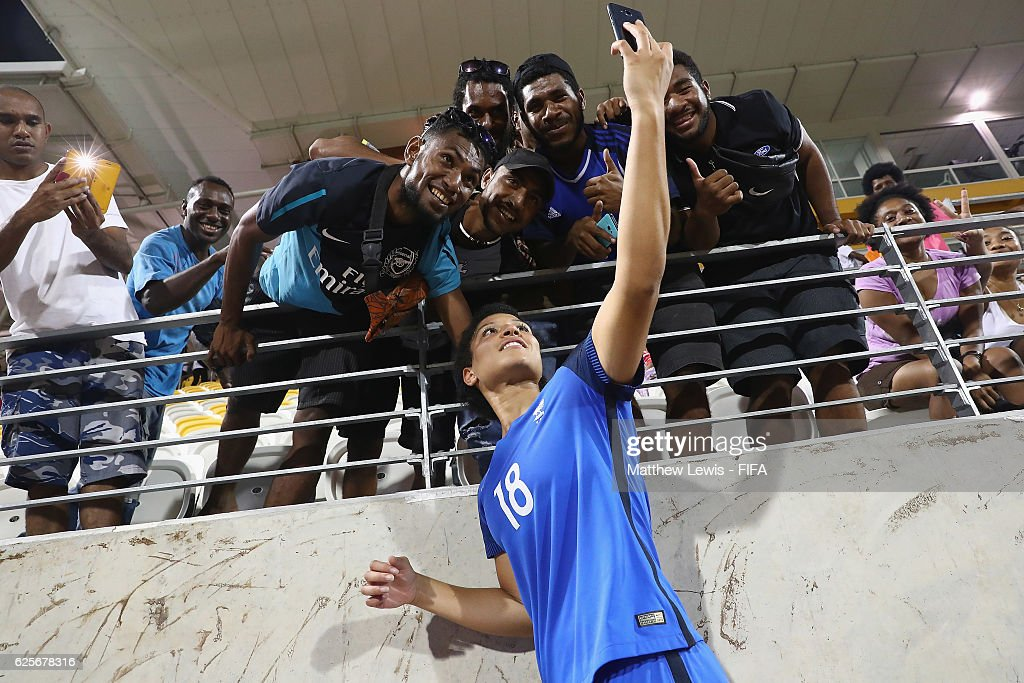 Valerie Gauvin of France takes a selfie with supporters after the FIFA U-20 Women's World Cup Papua New Guinea 2016 Quarter Final match between Germany and Fra