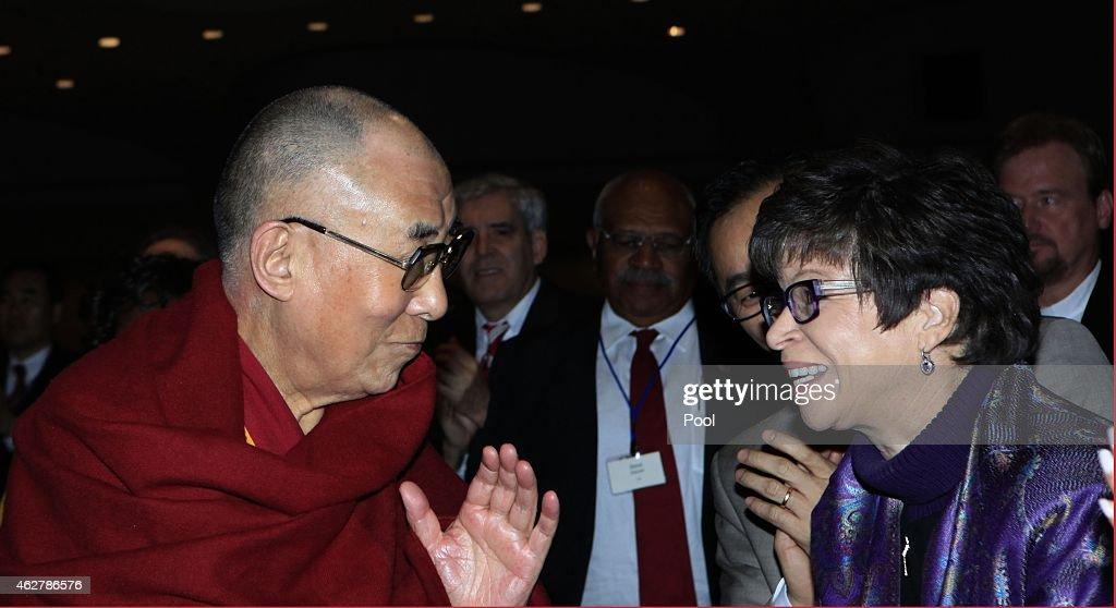 Valerie Jarrett Senior Advisor to President Obama talks to the Dalai Lama during the National Prayer Breakfast February 5 2015 in Washington DC...