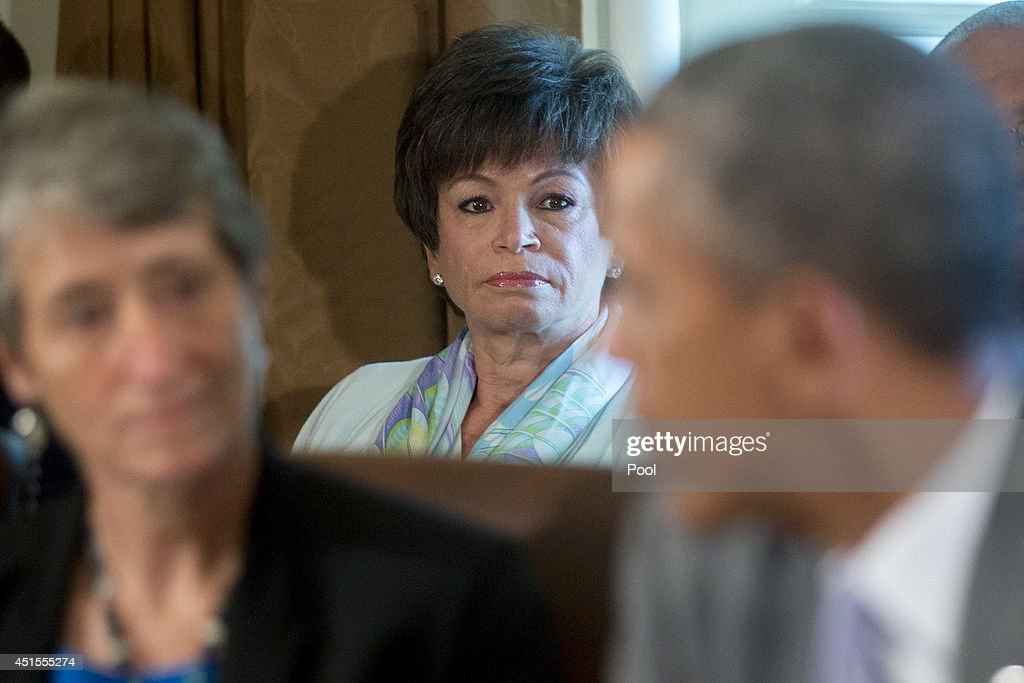 Valerie Jarrett senior advisor to US President Barack Obama looks on as Obama right speaks during a cabinet meeting at the White House on July 1 2014...