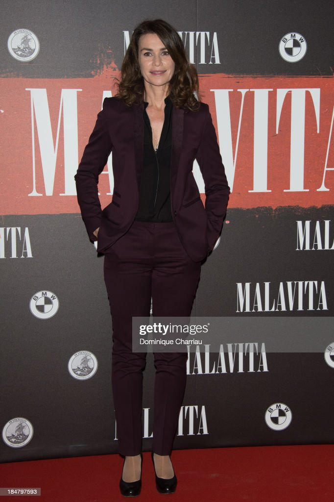 <a gi-track='captionPersonalityLinkClicked' href=/galleries/search?phrase=Valerie+Kaprisky&family=editorial&specificpeople=1623207 ng-click='$event.stopPropagation()'>Valerie Kaprisky</a> attends the 'Malavita' premiere at Europacorp Cinema on October 16, 2013 in Roissy-en-France, France.