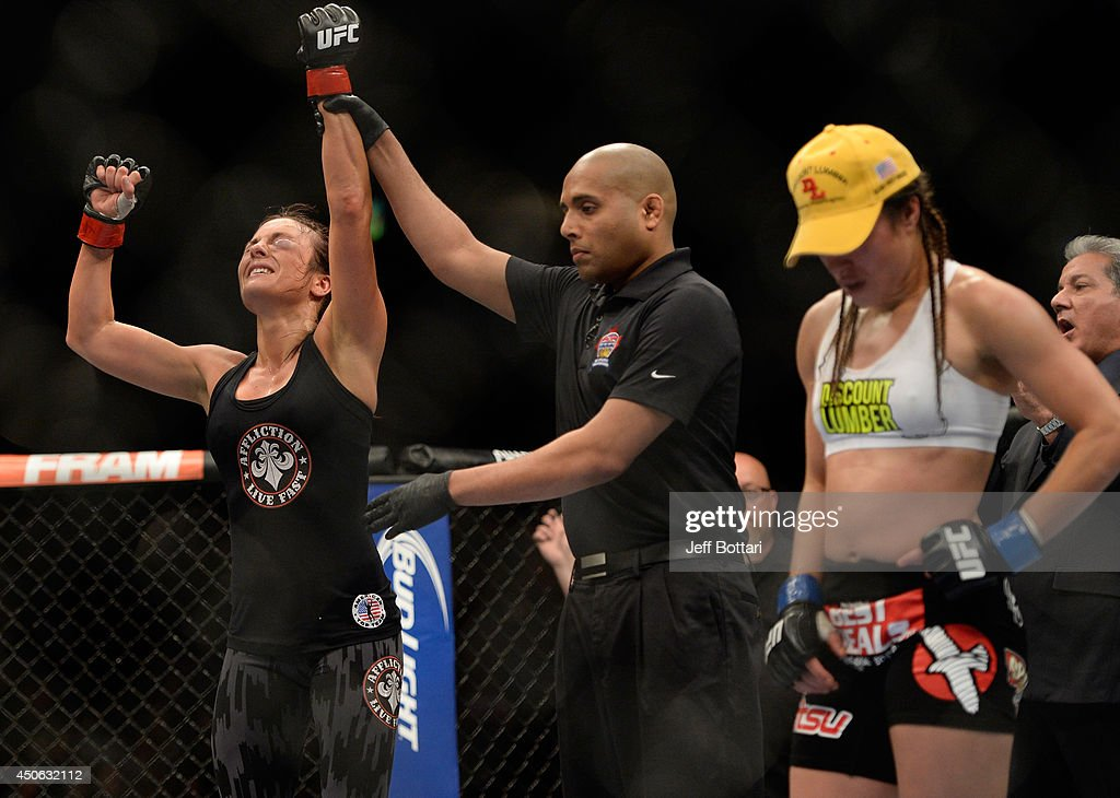 Valerie Latourneau celebrates after a split decision win over Elizabeth Phillips during the UFC 174 event at Rogers Arena on June 14, 2014 in Vancouver, British Columbia, Canada.