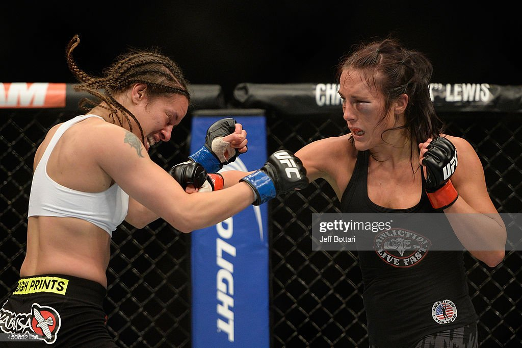 Valerie Latourneau punches Elizabeth Phillips during the UFC 174 event at Rogers Arena on June 14, 2014 in Vancouver, British Columbia, Canada.