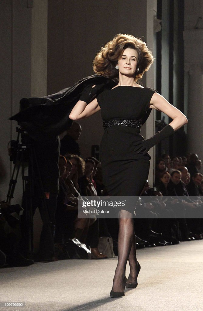 Valerie Lemercier walks the runway during the Loewe Ready to Wear Autumn/Winter 2011/2012 show during Paris Fashion Week at Ecole de Medecine on...
